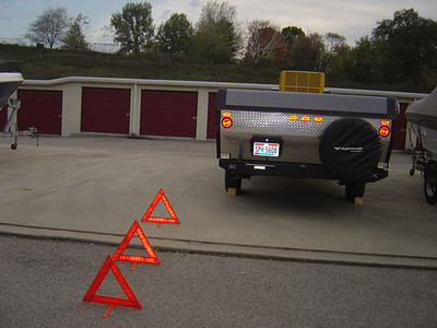 Apply brake, put gear in  1st or park, turn on flashers, lay out triangle signs (place them 100 feet apart from the PUP)