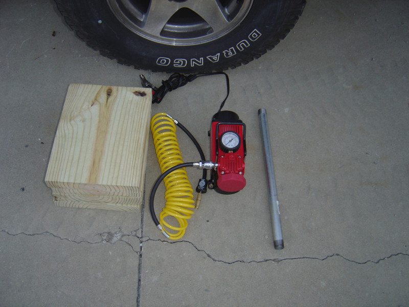 If needed you should have boards (not concrete blocks), air compressor and a pipe that will fit over the lug tool and give you more leverage.