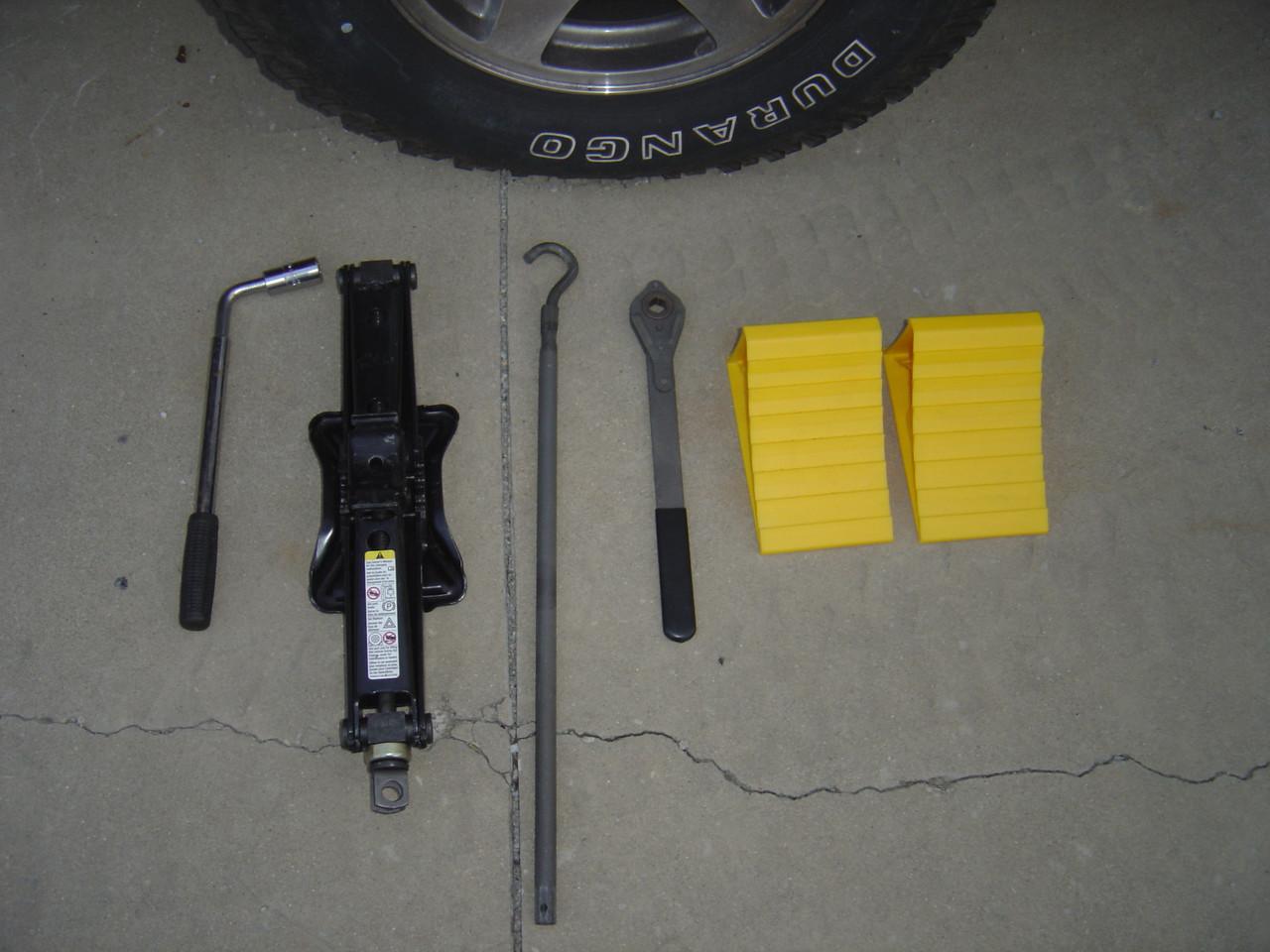 1.  Lug tool (adequate to remove both the wheel and spare), Jack and chocks