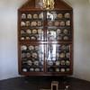 Cabinet full of skulls.