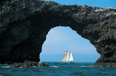 Channel Islands National Park, Anacapa Island, The Californian sails past forty-foot high Arch Rock