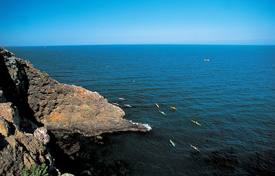 Ocean kayakers set off to explore some of Anacapa's 135 charted sea caves.