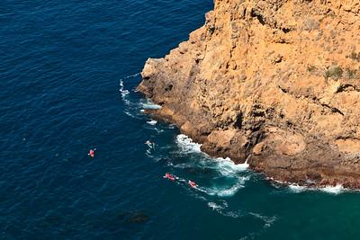 Potato Harbor - Kayakers exploring a sea cave near Potato Harbor
