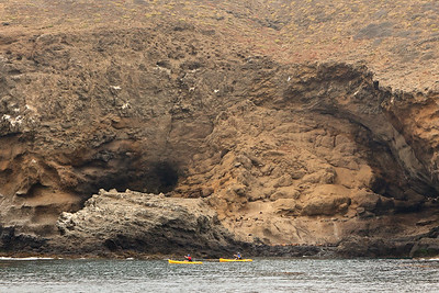 Kayakers exploring the island's coastline near the Sea Lion Rookery