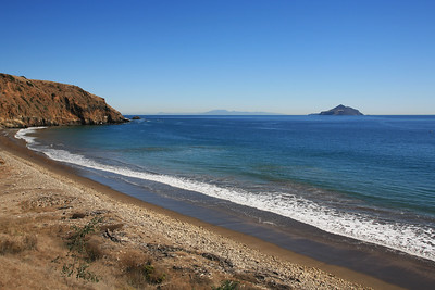 Smuggler's Cove with Anacapa Island visible in the right background, Santa Monica Mountains visible in the far distance.