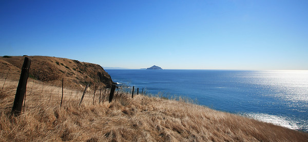 Remnants of past ranching days at Smuggler's Cove.  Anacapa Island visible in the far background