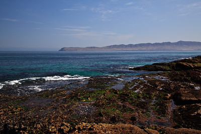 Jagged rocks and tide pools near Skunk Point.  In the background is Santa Cruz Island.