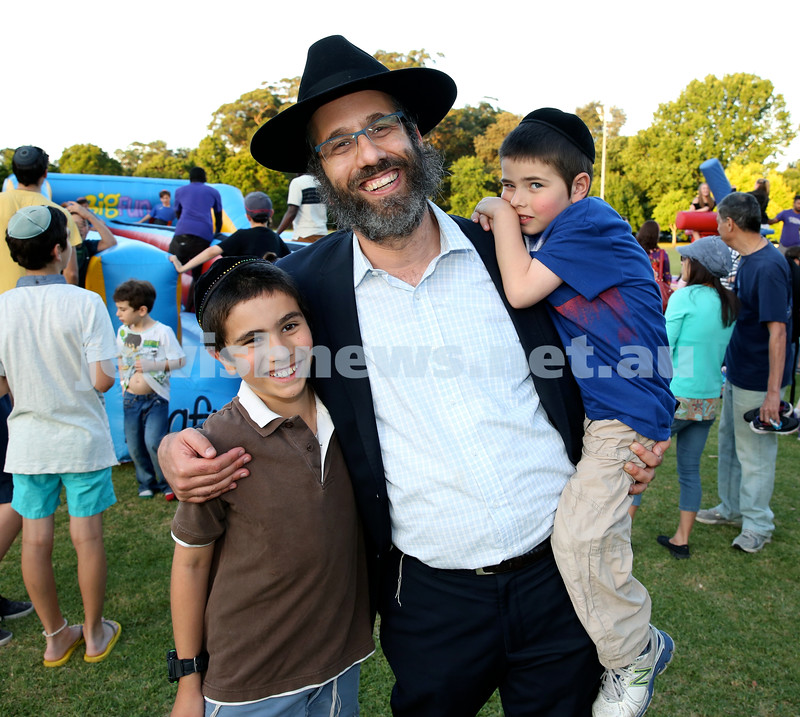 Chanukah on the Green combined North Shore shules Chanukah Party. Rabbi Zalman Kastel (M) with two of his sons Levi (L) & Tuvia (R). Pic Noel Kessel