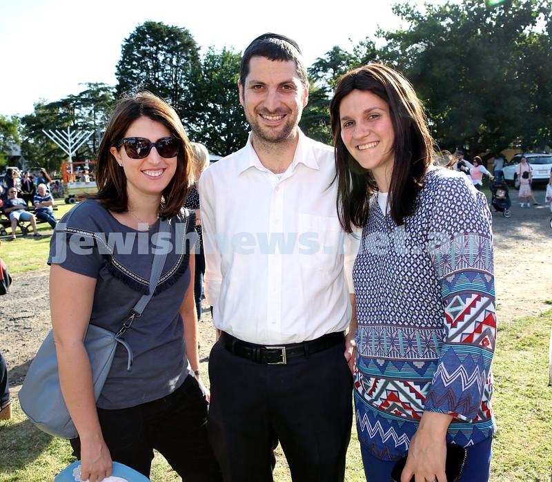Chanukah on the Green combined North Shore shules Chanukah Party. (From left) Talia Shotland, Brett & Lisa Cohen. Pic Noel Kessel.