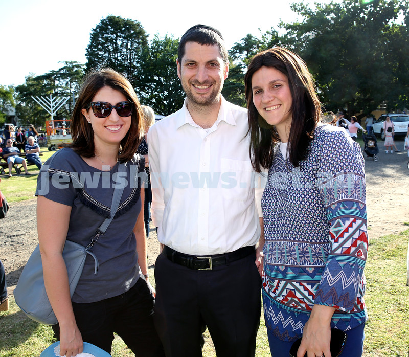 Chanukah on the Green combined North Shore shules Chanukah Party. (From left) Talia Shotland, Brett & Lisa Cohen. Pic Noel Kessel.