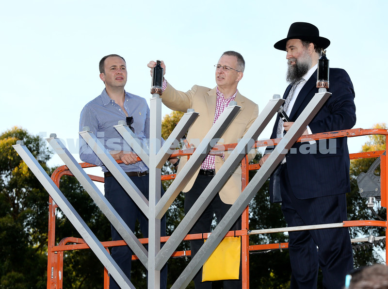 Chanukah on the Green combined North Shore shules Chanukah Party. (from left) MP Matt Kean, MP Paul Fletcher, Rabbi Nochum Schapiro light the Menorah. Pic Noel Kessel.