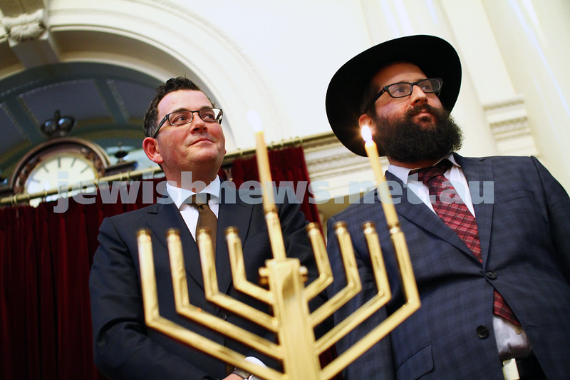 16-12-14. Chanukah at Queens Hall, Parliament House. Victorian Premier Daniel Andrews lights a chanukah candle with Rabbi Chaim Herzog from Chabad CBD. Photo: Peter Haskin