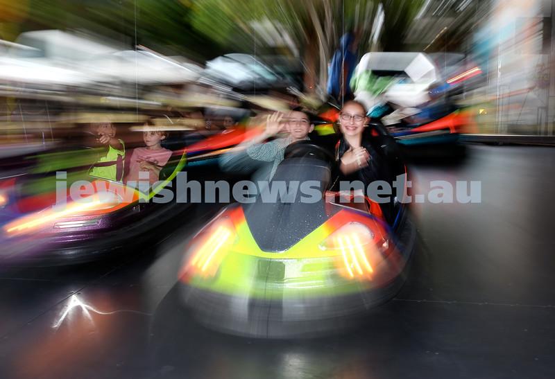Double Bay Chanukah Party in Steyne Park. Tzvika & Chanie Gershowitz on the dogem cars. Pic Noel Kessel.