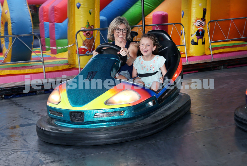 Double Bay Chanukah Party in Steyne Park. Trina Shneir with her daughter Daniella having funon a dogem car. Pic Noel Kessel.