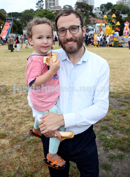 Chanukah at The Bay. Rabbi Yossi Friedman with his son Dovi. Pic Noel Kessel.