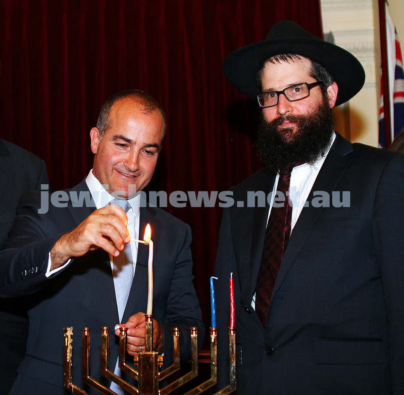 7-12-15. Chanukah at Victorian Parliament House. Deputy Premier James Merlino lights menorah with Rabbi Chaim Herzog from Chabad of CBD. Photo: Peter Haskin