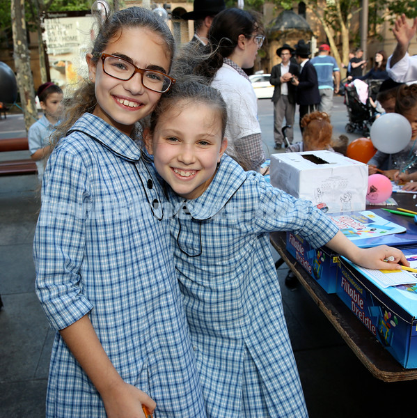Chanukah in Martin Place. Shaina Saban (left) & Chana Schapiro. Pic Noel Kessel.