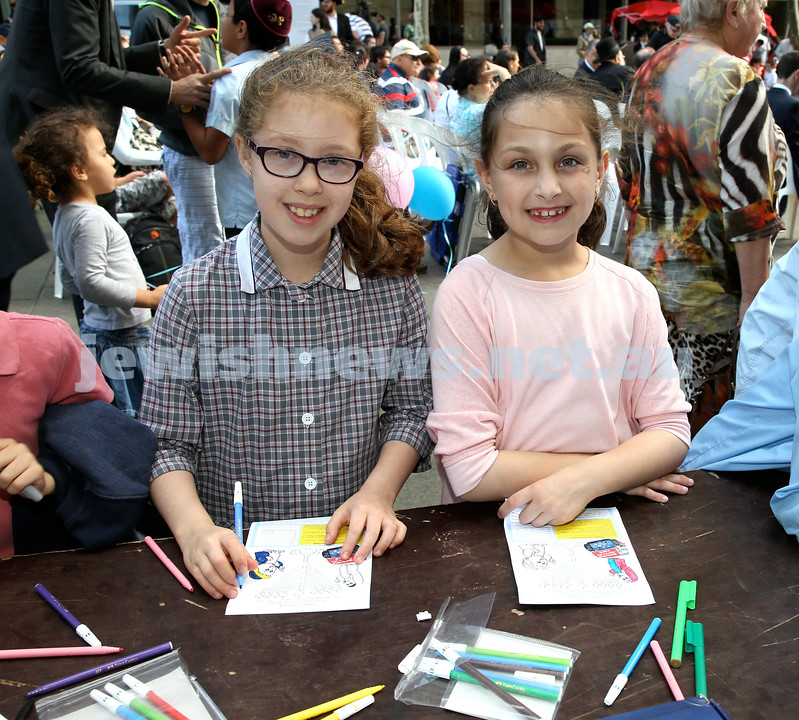Chanukah in Martin Place. Esther Willansky (left) & Chaya Greenwald. Pic Noel Kessel.