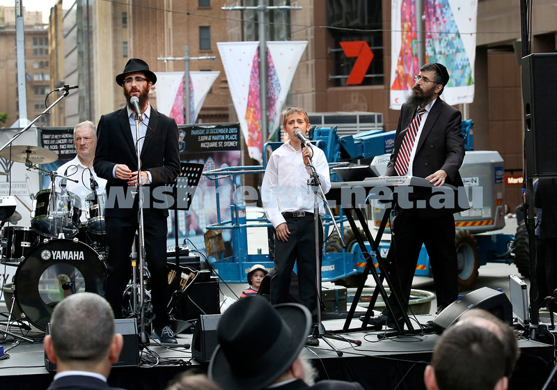 Chanukah in Martin Place. Concert featuring Eli Marcus (left) and supported by Levi & Yehoshua Niasoff. Pic Noel Kessel.