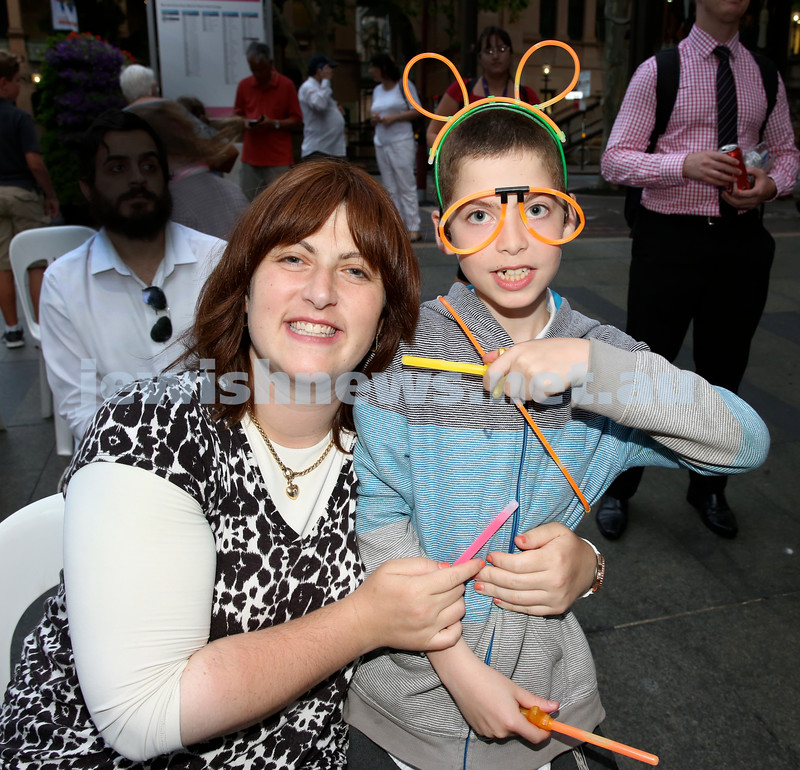 Chanukah in Martin Place. Sara Chana Sufrin with her son Mendel. Pic Noel Kessel.