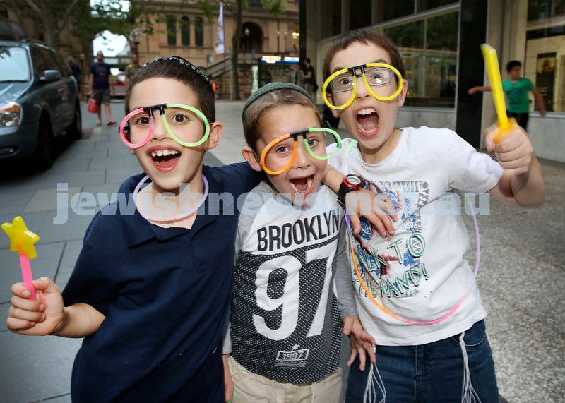 Chanukah in Martin Place.(from left) Araleh Richter,Pini Althouse, Mendy Blasenstein. Pic Noel Kessel.