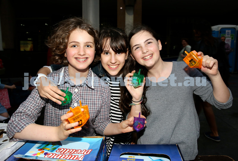 Chanukah in Martin Place. (From left) Fraida Feldman, Sarale Aber, Mushka Berger. Pic Noel Kessel.