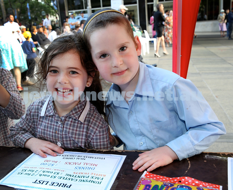 Chanukah in Martin Place. Chana Moss (left) & Gavi Sufrin. Pic Noel Kessel.