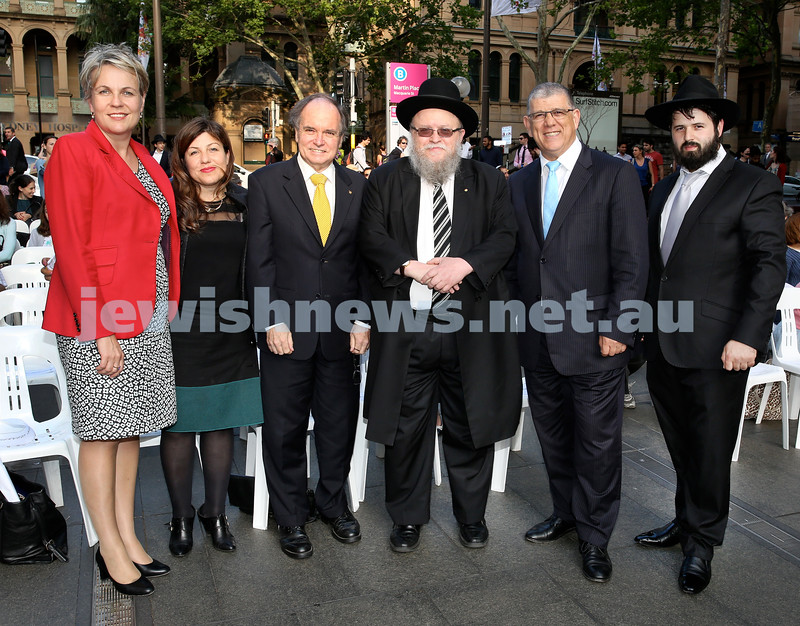 Chanukah in Martin Place. (From left) Tanya Pilbersek, Sophie Cotsis, David Clarke MP, Rabbi Pincus Feldman, John Ajaka MP, Rabbi Elimelech Levy. Pic Noel Kessel.