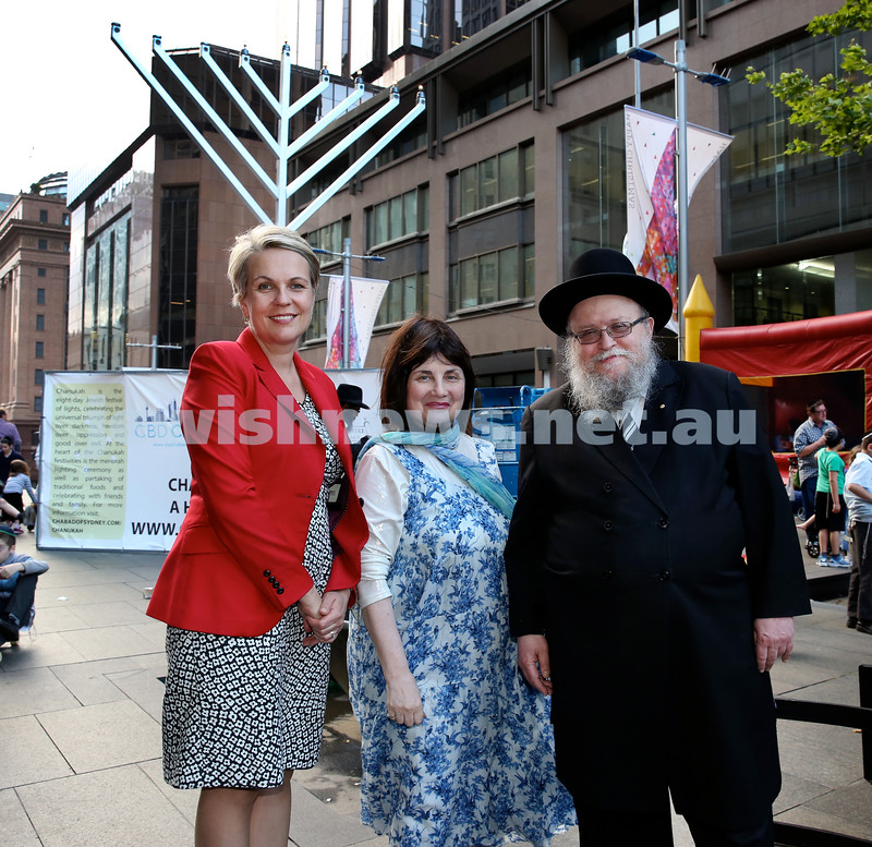 Chanukah in Martin Place. Tanya Pilbersek, Pnina & Rabbi Pincus Feldman. Pic Noel Kessel.