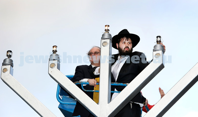 Chanukah at The Bay. Rabbi Elimelech Levy lights the Menorah alongside MP David Clarke. Pic Noel Kessel.