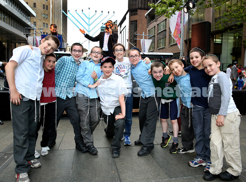 Chanukah in Martin Place. A group of Children enjoying the concert. Pic Noel Kessel.