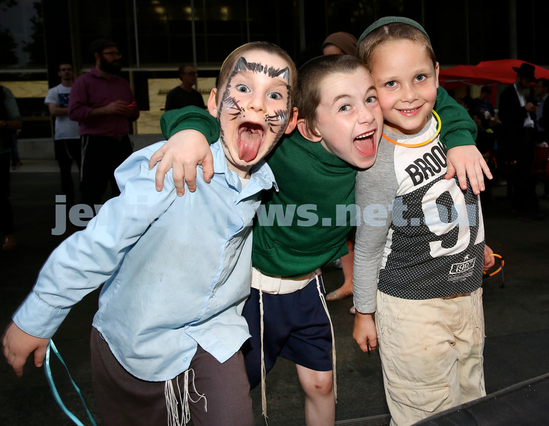 Chanukah in Martin Place. (from left) Gavi Sufrin, Mendel Moss, Pini Althouse. Pic Noel Kessel.