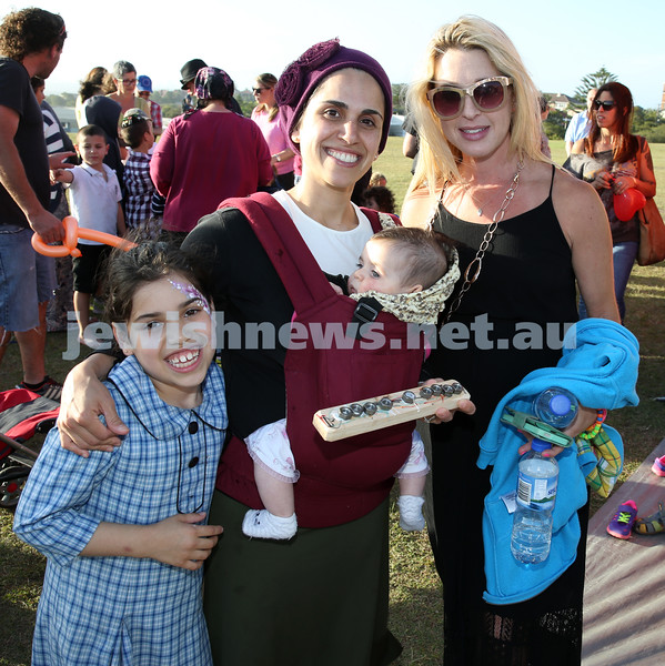 Dover Heights Shule Chanukah Party at Dudley Page Reserve. Simona Traurig with her daughters Elisheva & Nechama, with Loren Suntup.