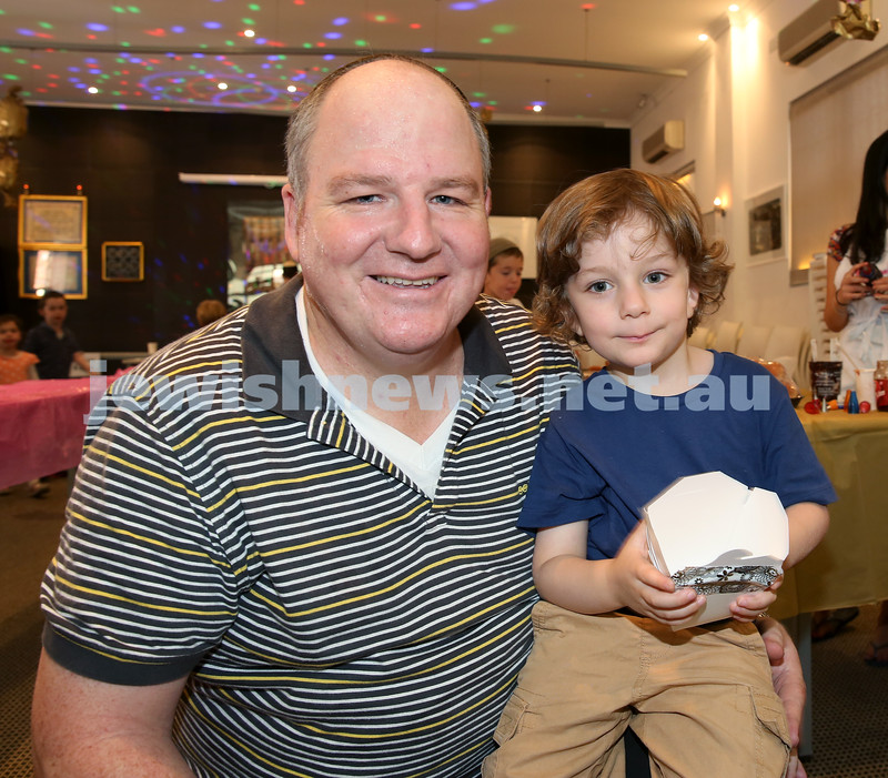 Nefesh Chanukah Party. Mark Van de Vyver with his son Lior.