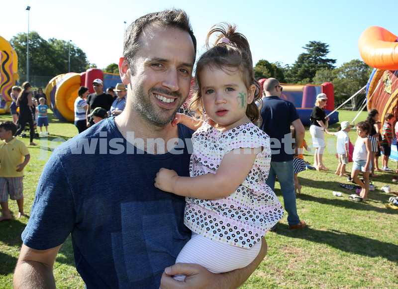 Combined North Shore Shules Chanukah Party held at St.Ives Village Green. Craig Shotland with his daughter Mila.