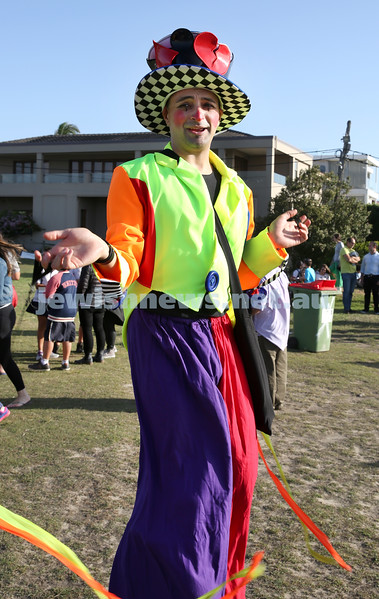 Dover Heights Shule Chanukah Party at Dudley Page Reserve. Daniel Britta the clown on stilts.