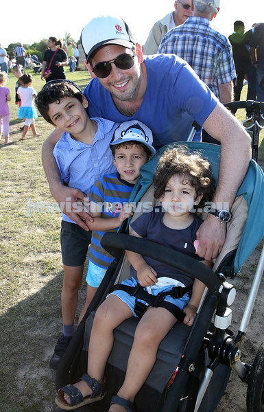 Dover Heights Shule Chanukah Party at Dudley Page Reserve. Baruch Kluwgant with his children Kovi, Yoni, Daniel.