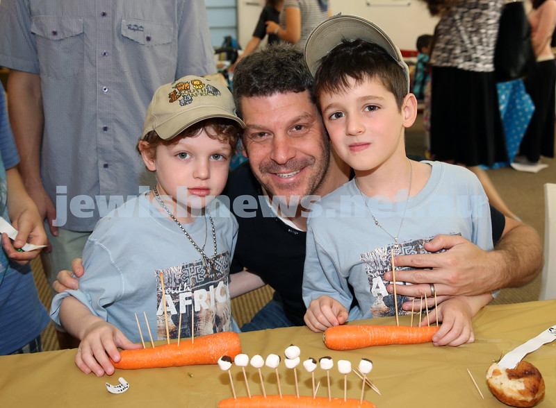 Nefesh Chanukah Party. Lance Suntup (M) with his children Jonjon and Aiden.