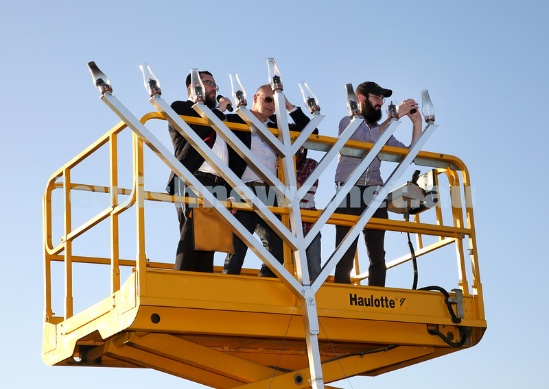 Dover Heights Shule Chanukah Party at Dudley Page Reserve. Rabbi Motti Feldman (L) Lighting the giant Menorah.