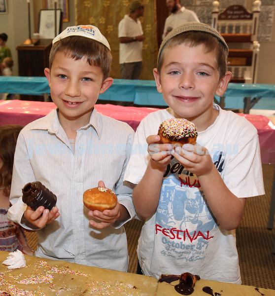 Nefesh Chanukah Party. Luke Myer & Yakir Lewis decorating their doughnuts.