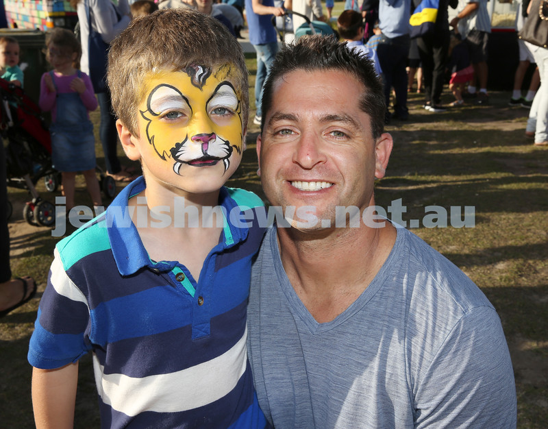 Dover Heights Shule Chanukah Party at Dudley Page Reserve. Gavin Fingleson with his son Rory.