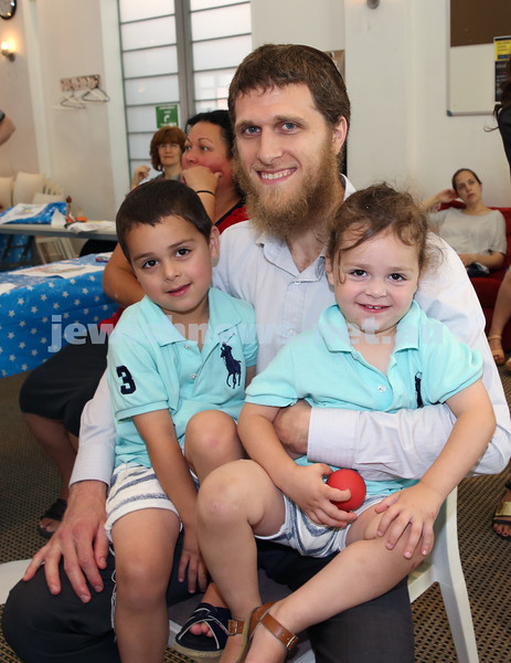 Nefesh Chanukah Party. Rabbi Chaim Koncepolski with his children Yitzchak & Zalman.