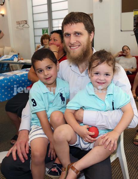 Nefesh Chanukah Party. Rabbi Chaim Koncepolski with his children Yitzchak & Zalman.