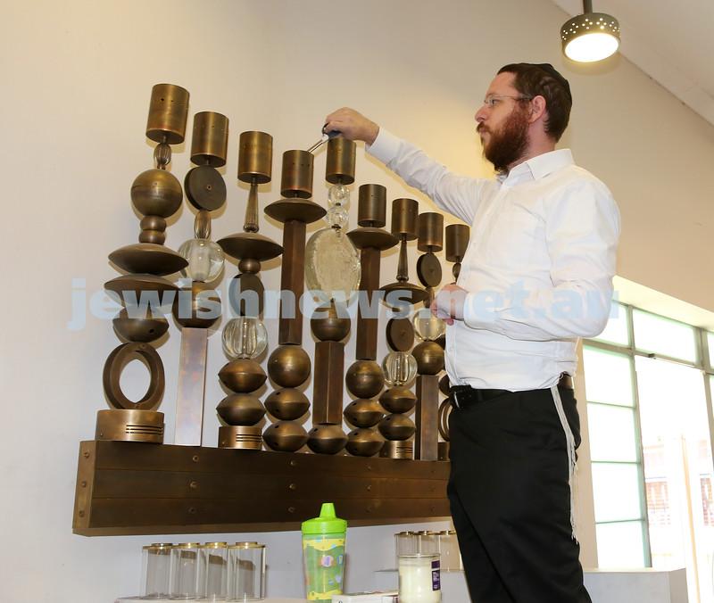 "Nefesh Chanukah Party. Rabbi Moss lights the ""Fire Menorah""."
