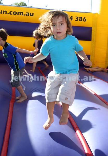Combined North Shore Shules Chanukah Party held at St.Ives Village Green. Gabriel Goodman jumping on the jumping Castle.