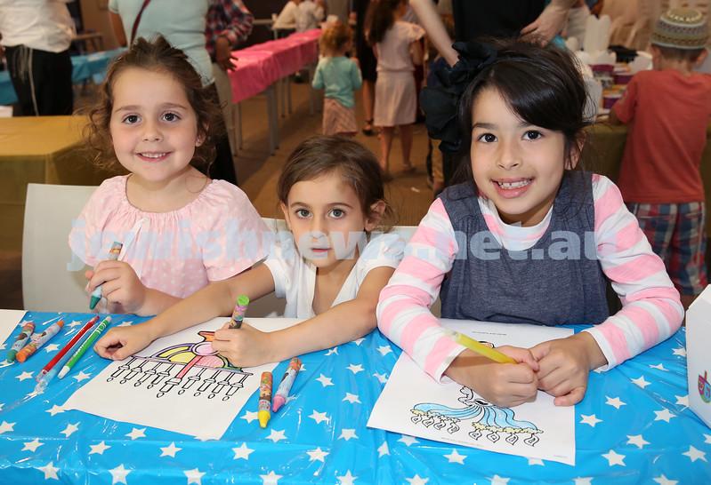Nefesh Chanukah Party. Ralia Raskin, Liana Weisz, Toby Komar.