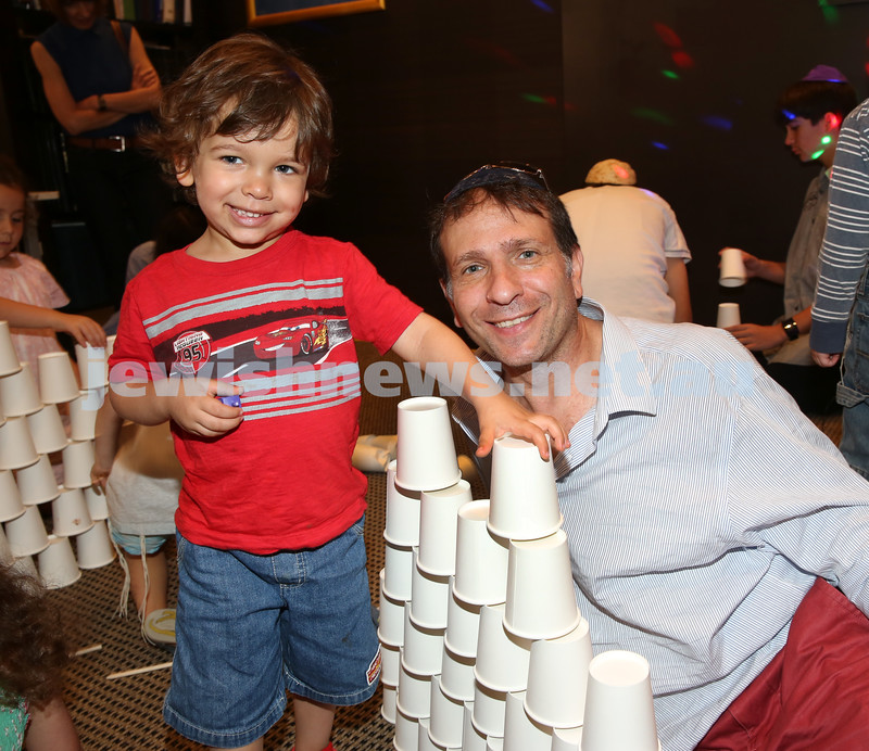 Nefesh Chanukah Party. Glenn Eisenberg with his son Aaron.
