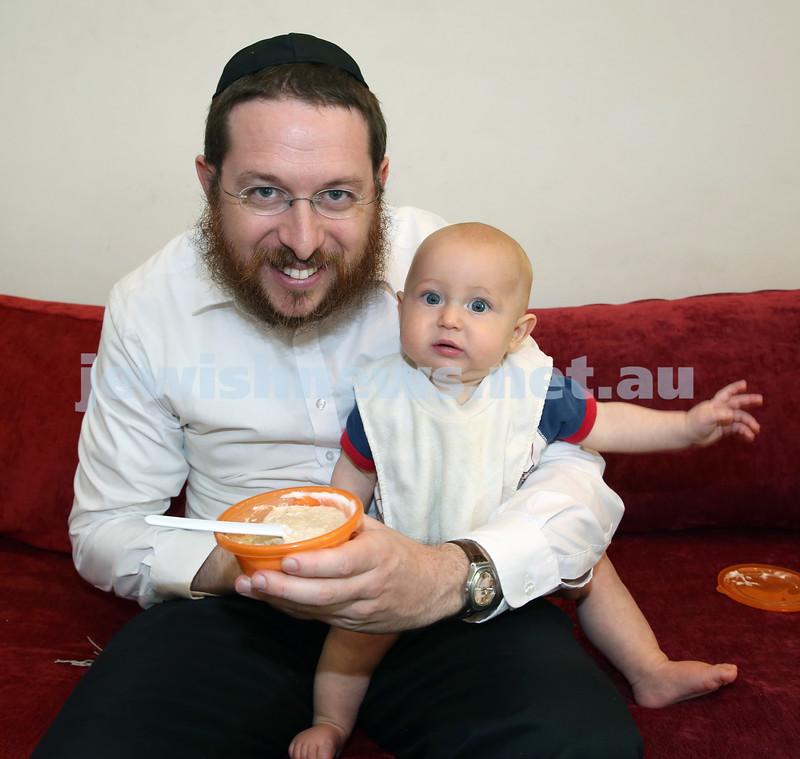 Nefesh Chanukah Party. Rabbi Aron Moss with his son Meir.