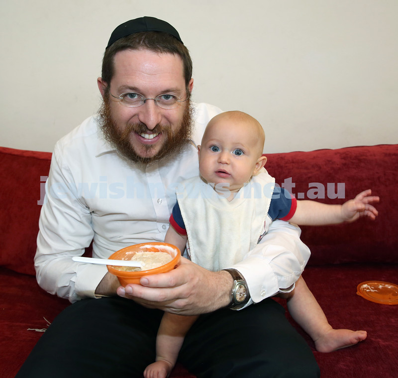 Nefesh Chanukah Party. Rabbi Aron Moss with his son Meir.