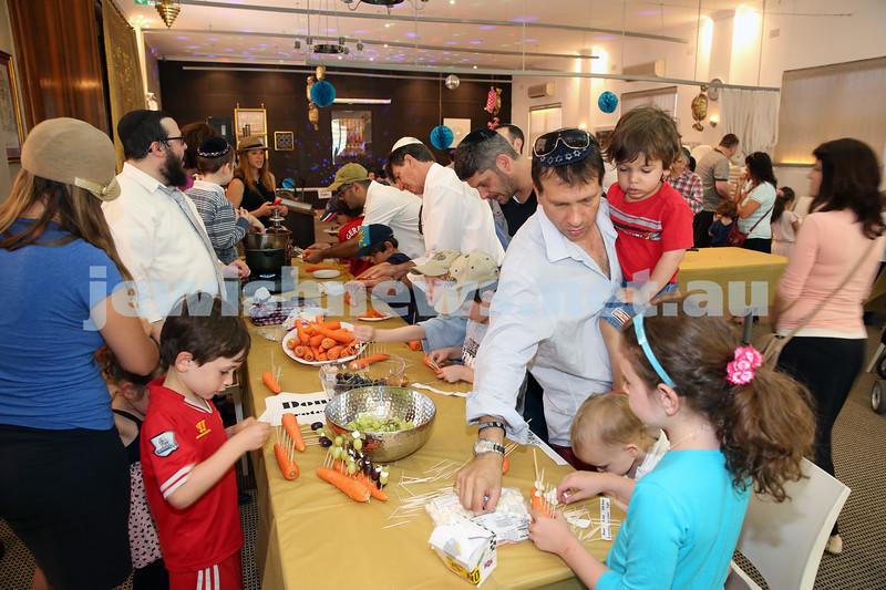 Nefesh Chanukah Party. Children make Chanukah Menoras from fruit, vegetables & Chocolate.